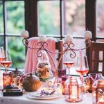 Picture of a fine dining holiday dinner table replete with candelabra, stemmed wine glasses, fine china and silverware. If you find it challenging navigating the holiday season, here are some helpful tips for having a happy and healthy holiday! If you're feeling overwhelmed by all the holidays have to offer, we are here to help! Contact us at Barrington Behavioral Health and Wellness; email help@barringtonbhw.com or call: 888-261-2178
