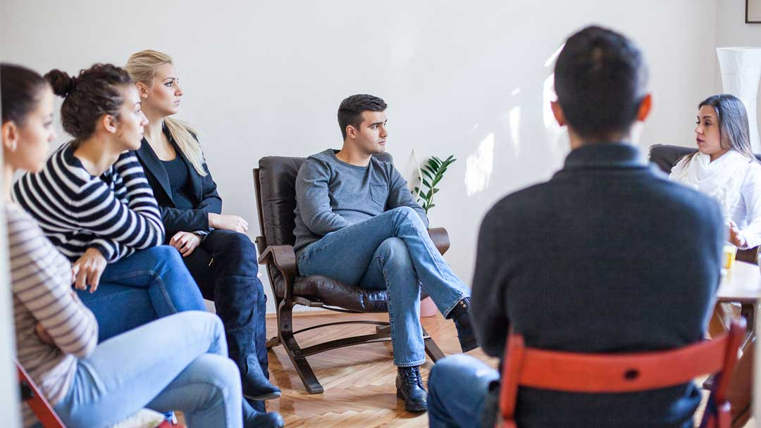 Picture of a small group of people in their thirties seated in a circle attending a DBT (Dialectic Behaviorl Therapy) support group. In this group, attendees learn new skills to manage emotions, stress, distress and how to practice 'mindfulness'. All of this allows the attendees to improve their interpersonal effectiveness. Contact Barrington Behavioral Health and Wellness to reserve your place in this group. Group begins January 18, 2020. Group meets weekly, Monday nights 6:30-8:00 pm: Phone: 888-261-2178 Email: help@barringtonbhw.com