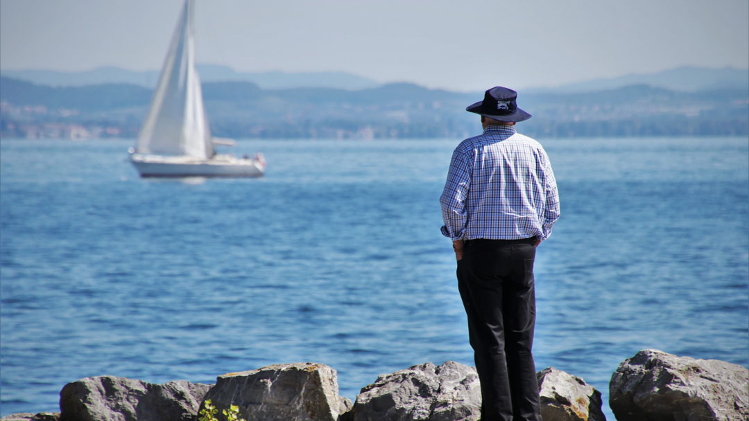 Picture of a man standing on a rocky shore looking out across a bay to a passing sailboat, the tree lined shore in the distance cleary in view. Mindfulness is taking pause, looking inward, finding balance, recognizing and embracing our fears, worries and anger so that we can take care of ourselves and those we love. If you would like to learn more about practicing mindfulness, contact; Barrington Behavioral Health and Wellness, 888-261-2178 or email: help@barringtonbhw.com