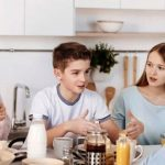 "A family of four is gathered around the kitchen counter over breakfast, having a family meeting. The young son is explaining something as his sister, to his left, mother and father listen carefully to his words. Gratitude and acceptance, being able to say ""I'm sorry"", are two of the greatest tools we have for maintaining and nurturing a healthy family unit. If you, or your family, need support through a difficult time, we can help. Email: help@barringtonbhw.com"