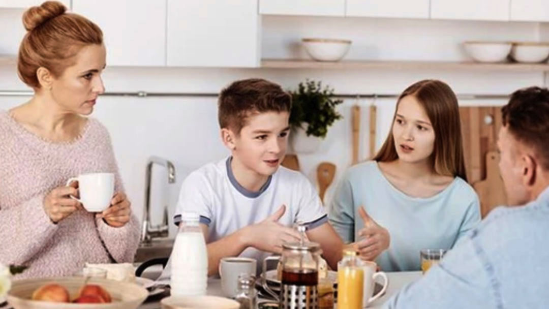 """A family of four is gathered around the kitchen counter over breakfast, having a family meeting. The young son is explaining something as his sister, to his left, mother and father listen carefully to his words. Gratitude and acceptance, being able to say """"I'm sorry"""", are two of the greatest tools we have for maintaining and nurturing a healthy family unit. If you, or your family, need support through a difficult time, we can help. Email: help@barringtonbhw.com"""